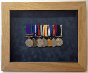Military medals in a removable frame