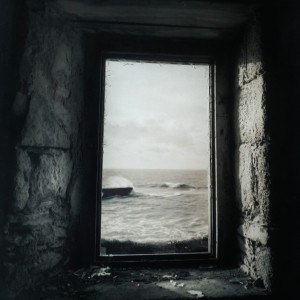 Clive Vincent – Porthleven pier through window